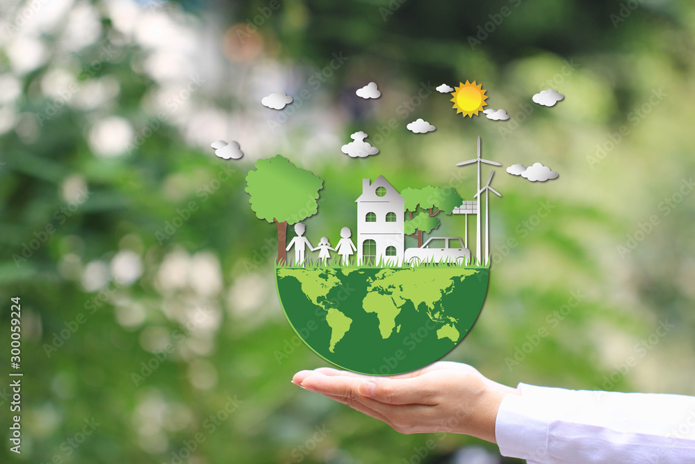Fototapety, obrazy: Woman hand holding green world with model house and model family on natural green background, We love the world of ideas