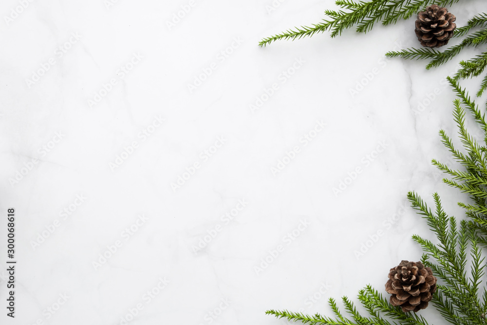 Fototapety, obrazy: White marble table with Christmas decoration including pine branches and pine cones. Merry Christmas and happy new year concept. Top view with copy space, flat lay.