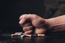 Male Hand Destroying Cigarette...