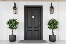 Black Front Door Of White House With Trees