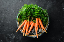 Fresh Carrots On A Black Stone...