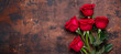 Leinwandbild Motiv Red rose flowers bouquet on wooden background Valentine's day greeting card Copy space Top view - Image