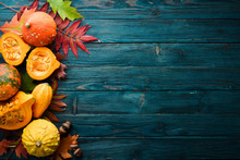 Autumn Vegetables. Colored Pumpkins With Autumn Leaves. Flat Lay. On A Blue Wooden Background. Top View. Free Space For Your Text.