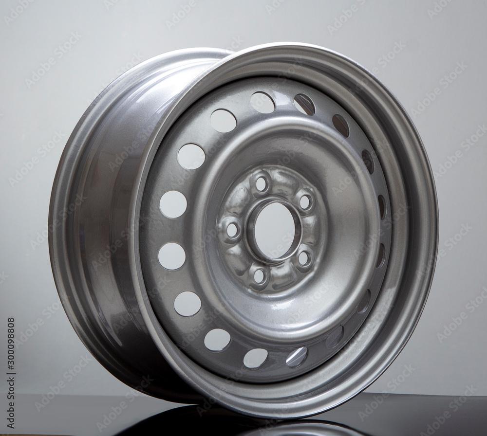 Fototapety, obrazy: Steel wheel rim on grey background