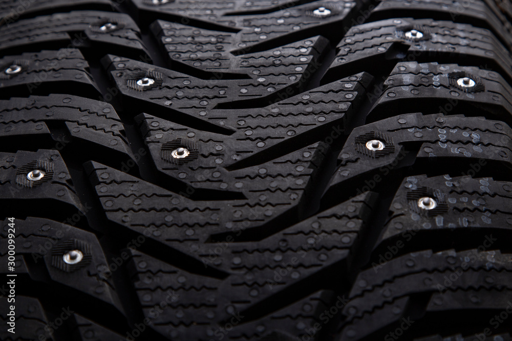 Fototapety, obrazy: Winter studded car tire with snow spikes