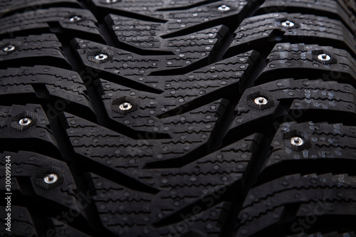 Poster Amsterdam Winter studded car tire with snow spikes