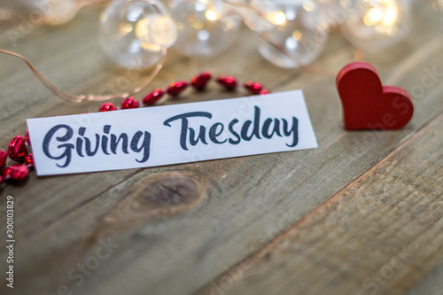 Fotomural  Giving Tuesday donate charity concept with text on wooden board
