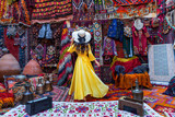 Beautiful girl at traditional carpet shop in Goreme city, Cappadocia in Turkey.