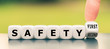 """Leinwanddruck Bild - Hand turns a dice and changes the expression """"safety second"""" to """"safety first"""""""