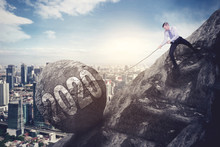 Caucasian Businessman Pulls Number 2020 On Cliff