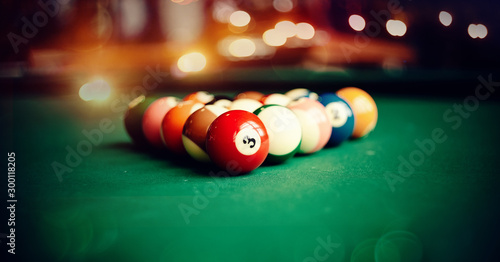 Fotomural Colorful billiard balls on a billiard table.