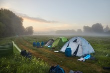 Tents On A Field In Early Morn...