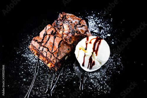 Fototapeta hot chocolate brownie dessert ice cream ball and slice of chocolate cake obraz