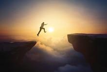 Male Entrepreneur Jumps Through Gap Cliff