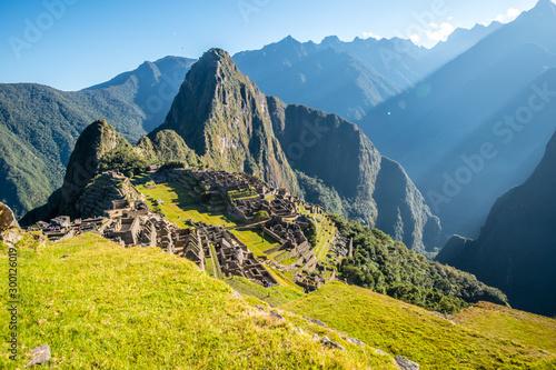 Sun rays above Inca ruins of Machu Picchu archeological site, Cusco, Peru, South Fototapeta