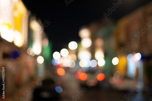 Fototapeta Abstract  colorful light bokeh in small town