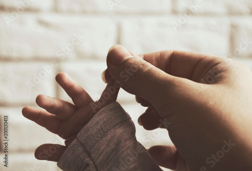 beautiful hands of the baby and the mother against a brick wall Canvas Print