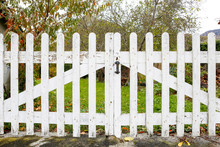 White Fence With Wooden Fence