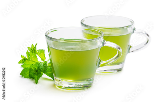 Garden Poster Tea Green mint tea in clear glass cups isolated on white