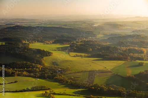 Fototapety, obrazy: Aerial photograph of sunset over Czech Highlands with farmlands and forests
