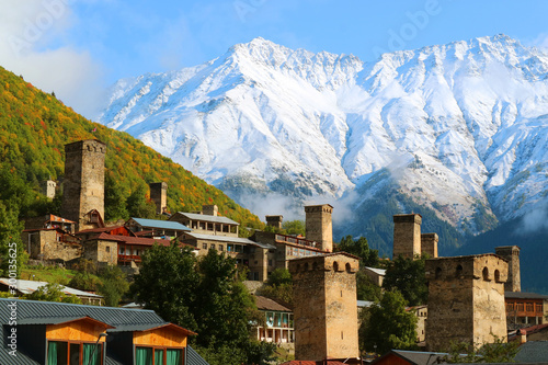 Fototapeta  Stunning View of Medieval Svan Tower-houses against the Snow-capped Caucasus Mou
