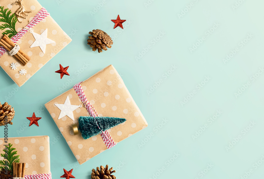Fototapeta Handmade Christmas gift boxes with ornaments - flat lay