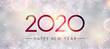 Blurred shiny Happy New Year 2020 banner with snowflakes.