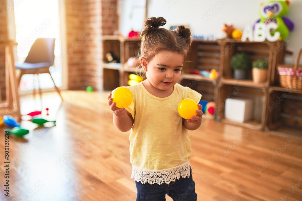 Fototapety, obrazy: Beautiful toddler playing with colorful balls at kindergarten