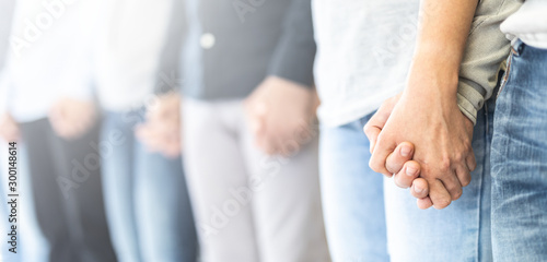 Photo Patients on group therapy are holding hands.
