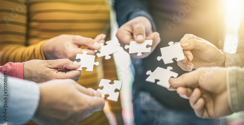 A group of business people assembling jigsaw puzzle. Wallpaper Mural