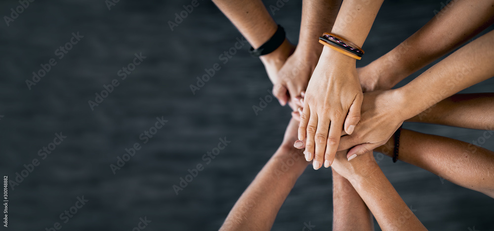 Fototapeta Stack of hands. Unity and teamwork concept.