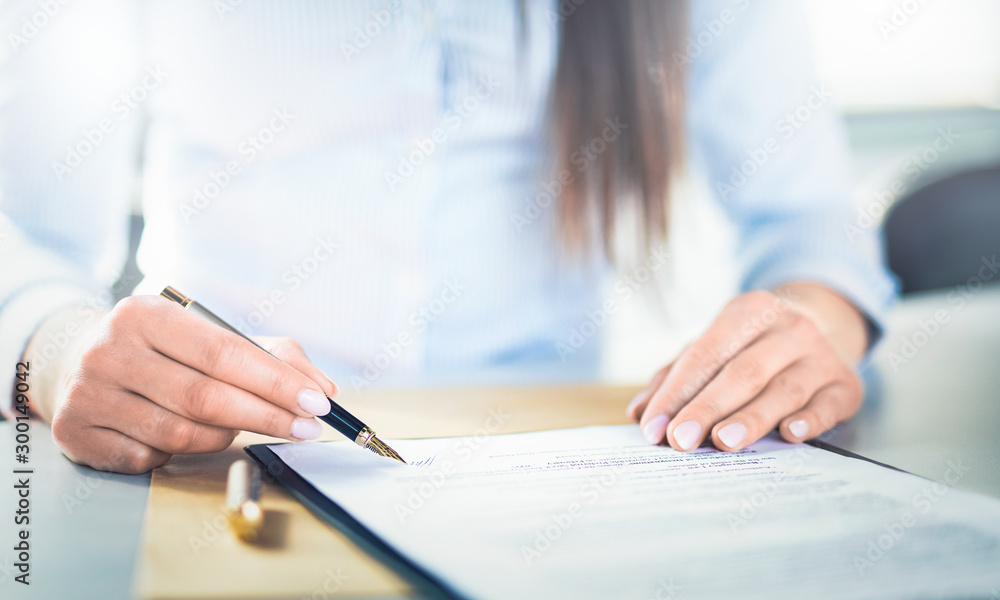 Fototapety, obrazy: Business woman signing contract, making a deal.