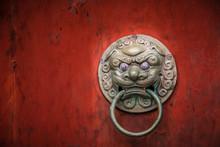 Lion Head Door Knocker On A Re...
