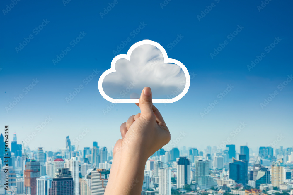 Fototapety, obrazy: Concept of download on cloud storage.Woman hand holding picture on cloud sky background. The development of the imagination, copy space.