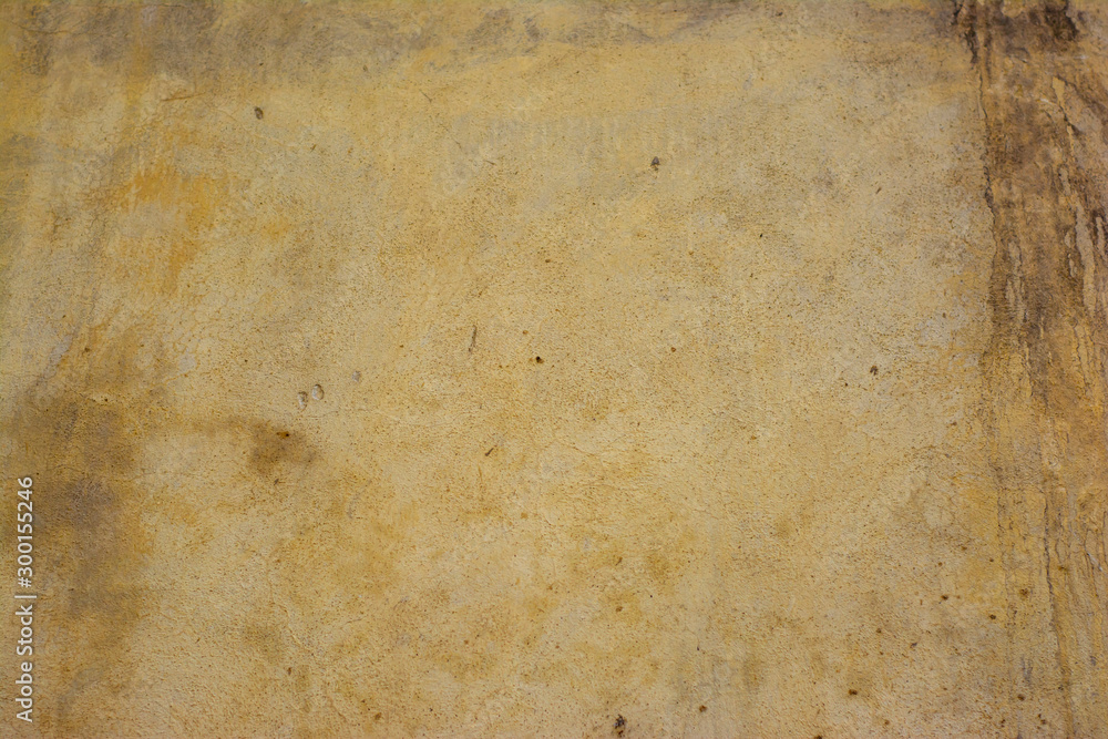 Fototapeta Concrete surface painted in light pastel colors with a rough texture.