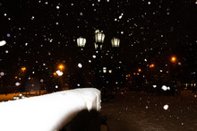 Lamppost With Five Lights At Night In Winter In A Blizzard.