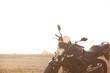 One black motorcycle in the desert.