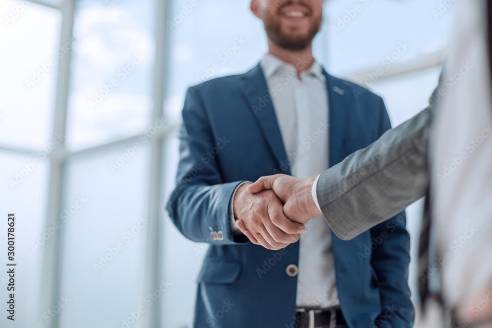 Fototapeta business partners shaking hands . concept of partnership
