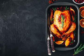 Roasted chicken or turkey with spices, oranges and cranberries for Christmas or Thanksgiving