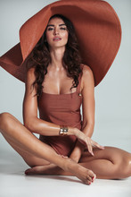 Brunette Model Wearing A Modern, Fashionable Hat - Isolated