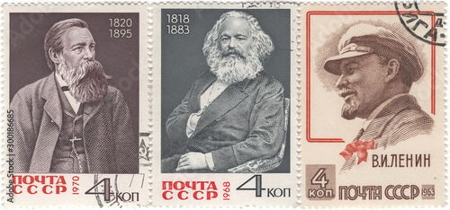 Fotografiet USSR-circa 1963: Three postage stamps of the USSR depicting Friedrich Engels (1829-1895), Karl Marx (1818-1883) and Vladimir Lenin (1870-1924), the founders of Marxism-Leninism