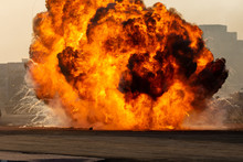 Massive Fire Explosion Or Strike In Military Combat And War. Vehicle Explosion From A Tank In A City In The Middle East. Military Concept. Strength, Power, Explosion.