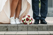 canvas print picture - Bride and groom wedding bouquet on the floor. The concept of marriage, family relationships, wedding paraphernalia.