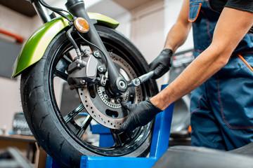 Repairing motorcycle at the workshop