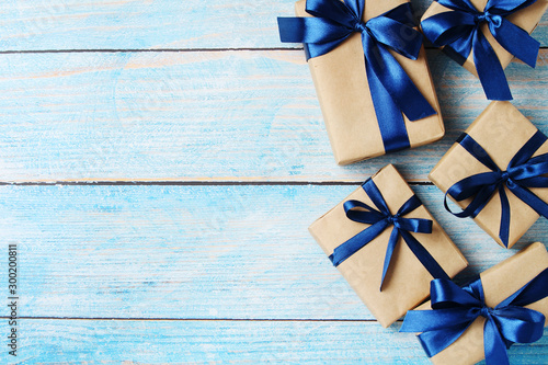 Wrapped gifts for holidays flat lay background Fotobehang