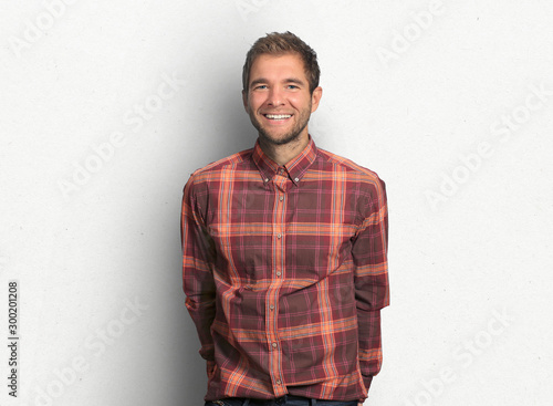 Young man in denim shirt is smiling