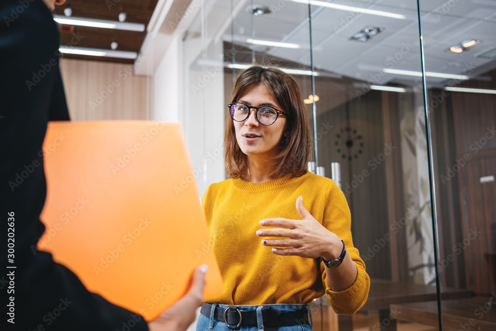 Fototapeta Group of positive female office employees have meeting at workplace at modern office. Business people discussing together working process