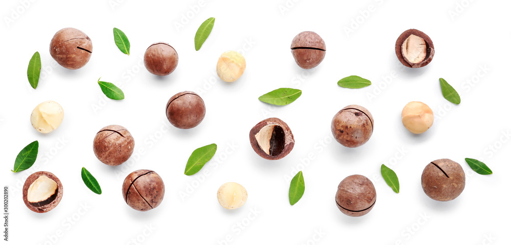 Fototapeta Tasty macadamia nuts on white background