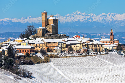 Small medieval town on snowy hill in Italy.