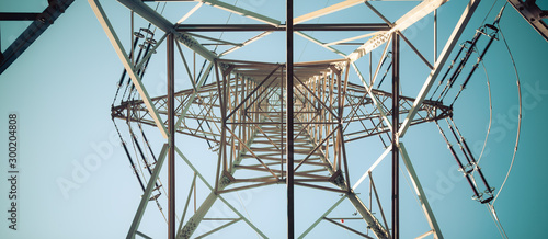 Close up of electrical tower and blue sky. Renewable energy and smart grid.